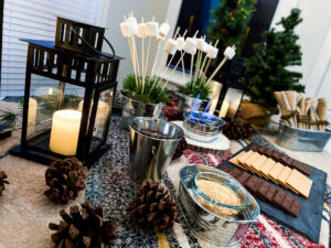 A cute campfire tablescape is the perfect set up for this party.