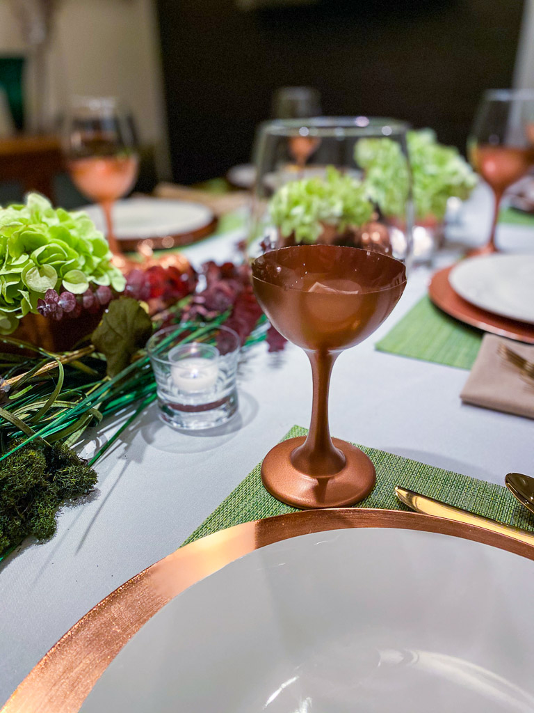 fall table centerpiece, fall table decor ideas, ideas for fall table decorations, fall table ideas, fall table setting ideas, fall decor ideas, simple fall tablescapes, fall tablescape ideas, fall table decor, fall table decorations ideas, modern fall table decor, fall decorating trends, fall decorating ideas, fall decor 2021, autumn table decorating ideas, copper home decor, copper home accents, eucalyptus centerpiece, green hydrangea centerpiece, copper pumpkins, copper wine glasses, copper chargers, gold flatware, gold utensils, white tablecloth, give thanks plates, thanksgiving, fall dinner party