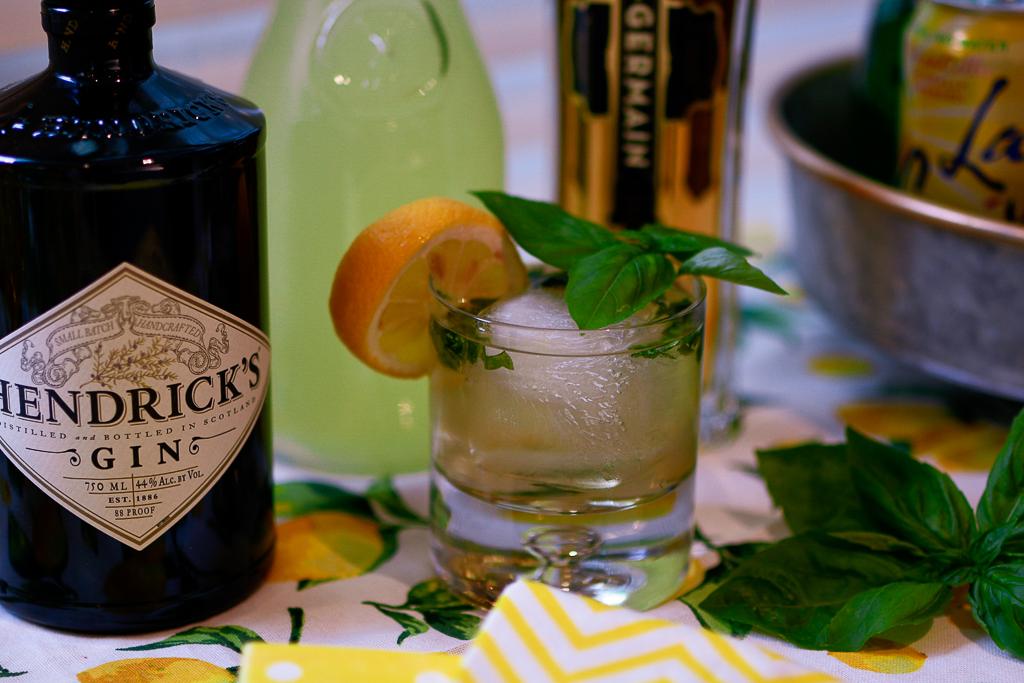 best alcohol to mix with lemonade, lemonade cocktail recipes, lemonade cocktails, gin lemonade cocktail recipes, galvanized tiered stand with lemons, lemon table runner, yellow and white check tablecloth, striped yellow napkins, yellow polka dot napkin, hendrick's gin recipe, St. Germain recipe, lemon theme decor, lemon theme party ideas, lemonade party ideas